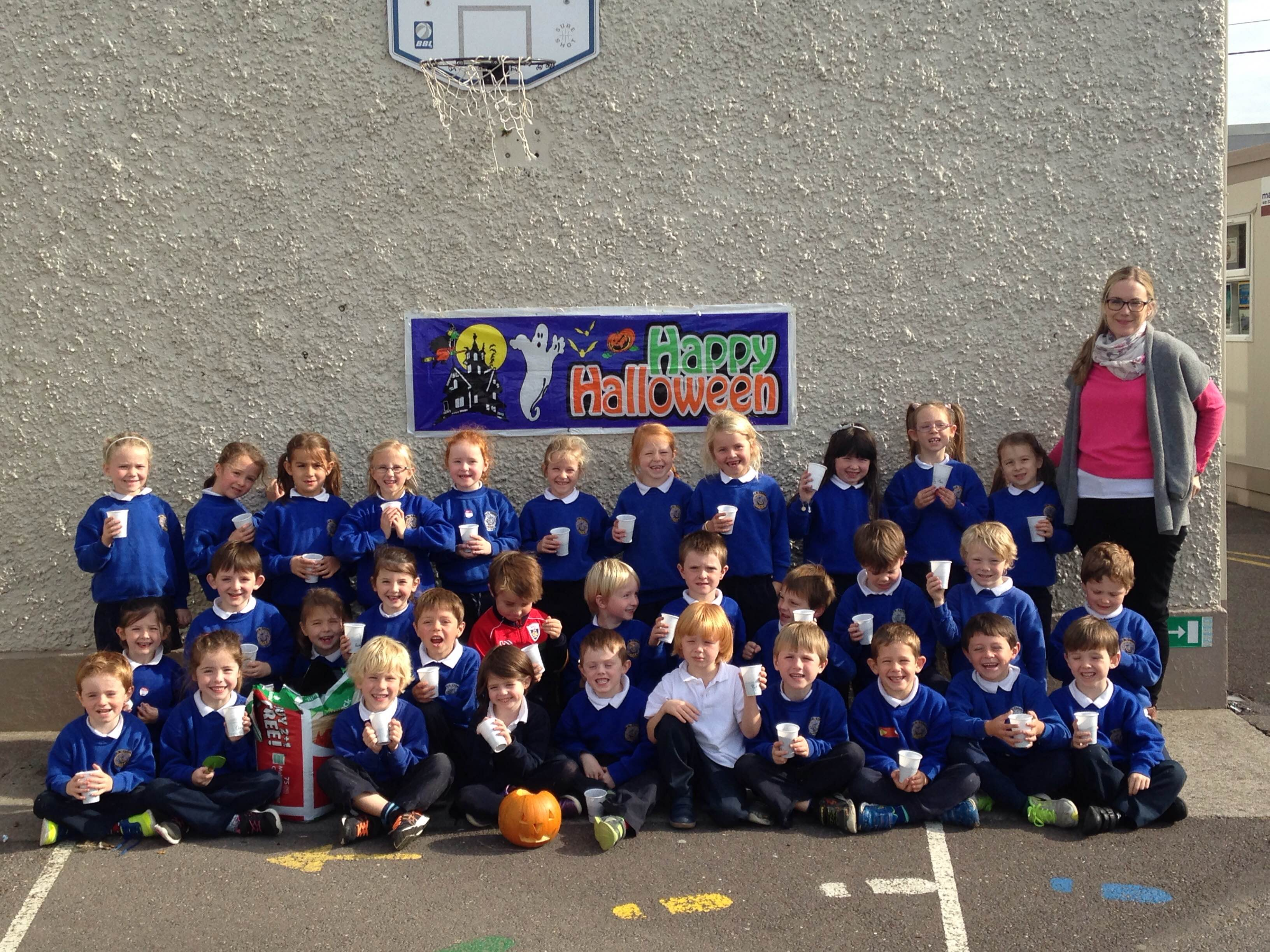 Senior Infants Planting Pumpkin Seeds