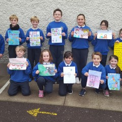 Children from all classes showing their positive messages about mental health.